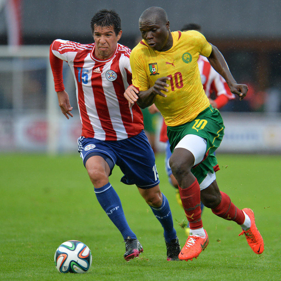 Photo - Cameroon's Vincent Aboubakar, right, and Paraguay 's Caceres Vitor, challenge for the ball during their friendly soccer match in Kufstein, Austrian province of Tyrol, Thursday, May 29. 2014. (AP Photo/Kerstin Joensson)