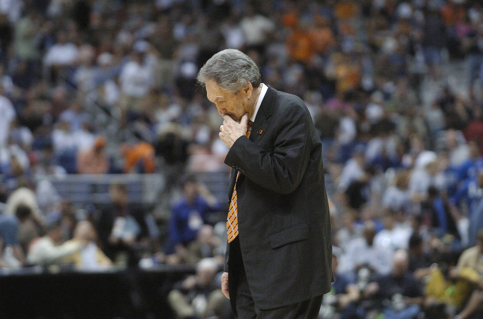 Photo - SAN ANTONIO, TEXAS, SATURDAY, APRIL 3, 2004. OKLAHOMA STATE UNIVERSITY  (OSU)  VS GEORGIA TECH COLLEGE BASKETBALL.  Oklahoma State head coach Eddie Sutton looks down in the first half of their NCAA Tournament Men's Final Four semifinal game at the Alamodome in San Antonio, Texas, Saturday, April 3, 2004.  Staff photo by Bryan Terry.