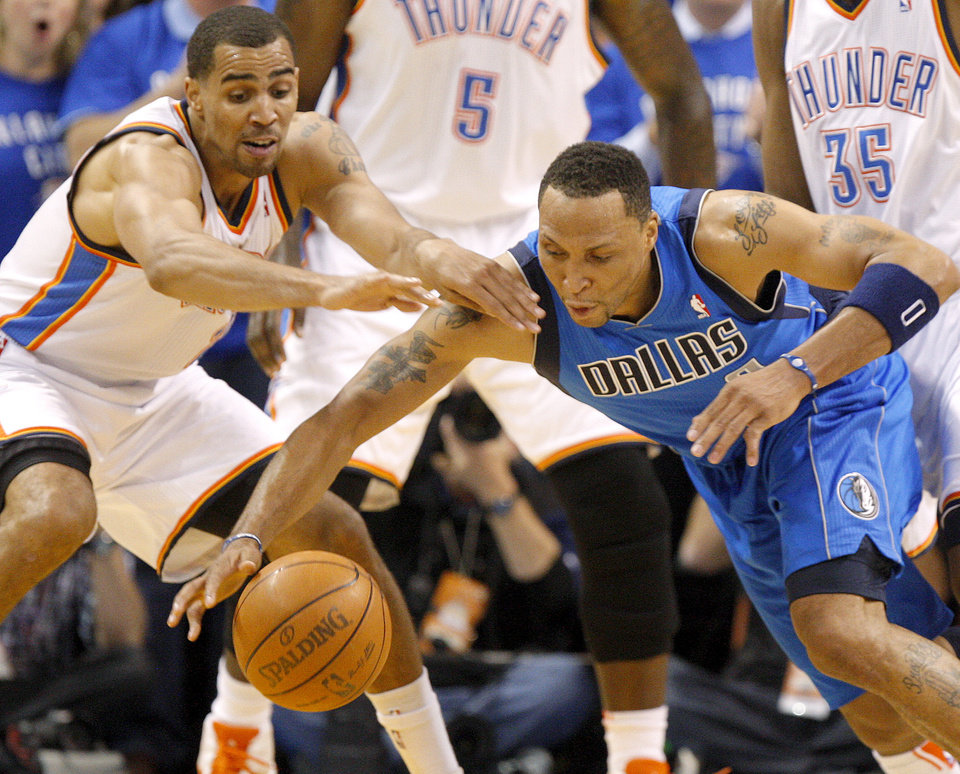 Oklahoma City's Thabo Sefolosha (2) and Shawn Marion (0) of Dallas  go for the ball during game 4 of the Western Conference Finals in the NBA basketball playoffs between the Dallas Mavericks and the Oklahoma City Thunder at the Oklahoma City Arena in downtown Oklahoma City, Monday, May 23, 2011. Photo by Nate Billings, The Oklahoman