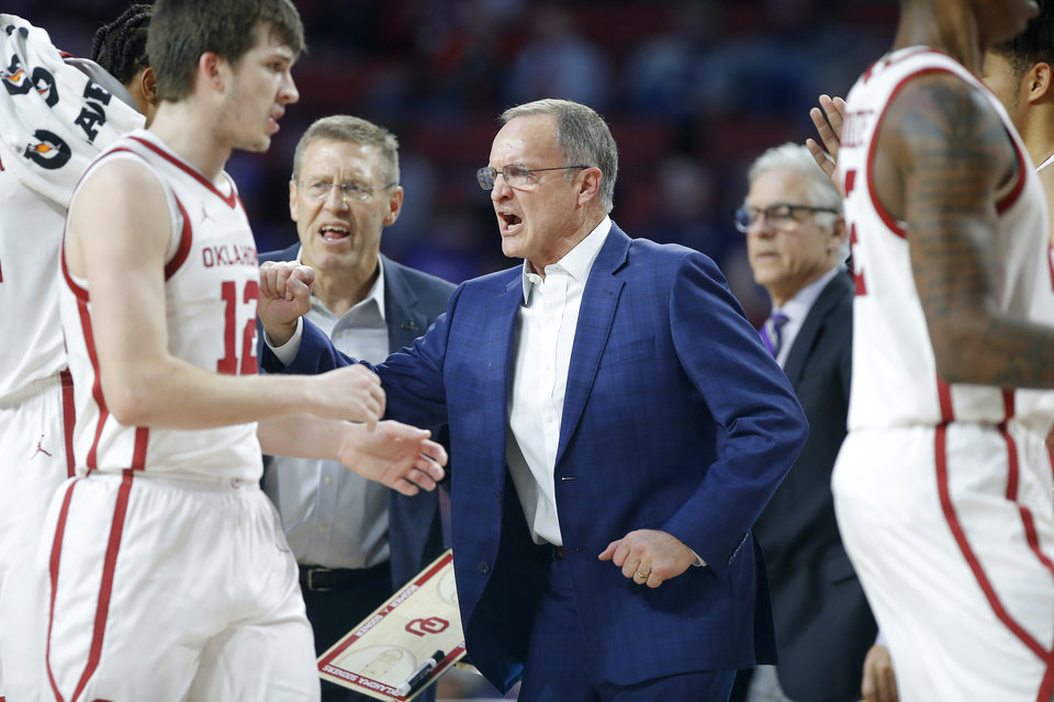 Photo - Oklahoma coach Lon Kruger greets his team during a timeout in an NCAA college basketball game between the University of Oklahoma Sooners (OU) and the Kansas State Wildcats at Lloyd Noble Center in Norman, Okla., Saturday, Jan. 4, 2020. Oklahoma won 66-61. [Bryan Terry/The Oklahoman]