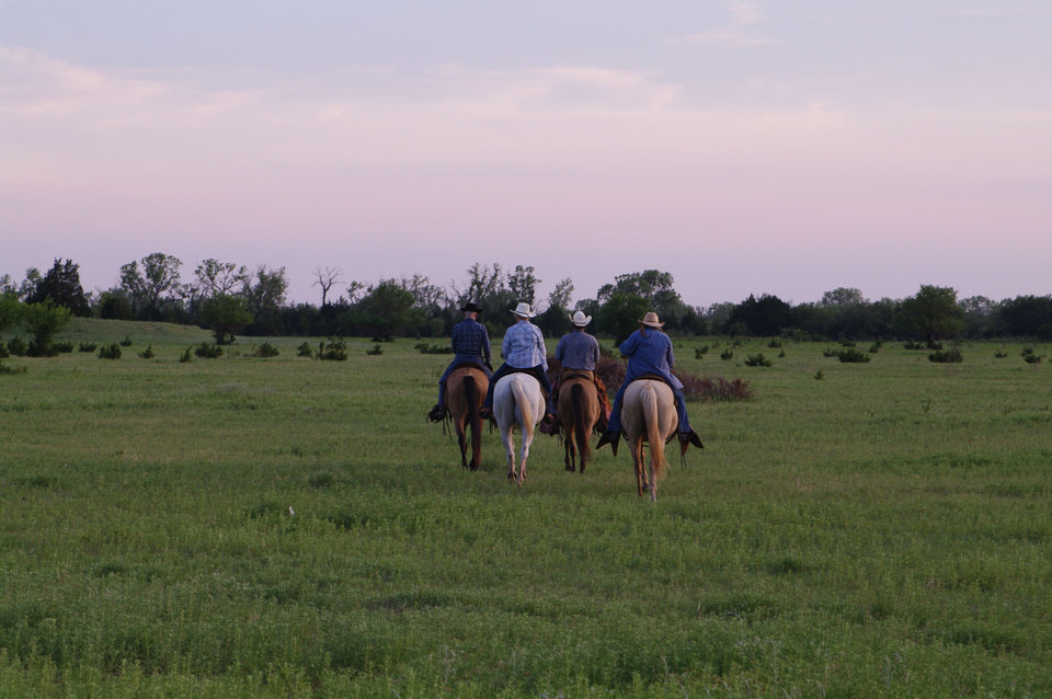 Photo - Guests at Island Guest Ranch near Ames in northwest Oklahoma ride horses. Photo provided