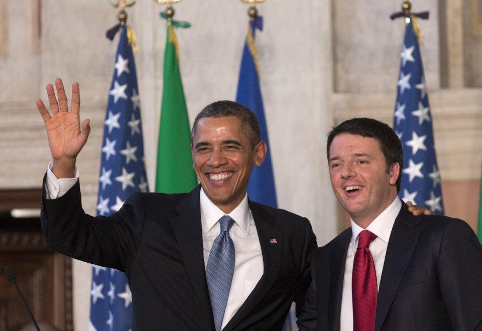 Photo - President Barack Obama and Italian Premier Matteo Renzi greet reporters at the end of their joint press conference at Rome's Villa Madama Thursday, March 27, 2014. (AP Photo/Alessandra Tarantino)