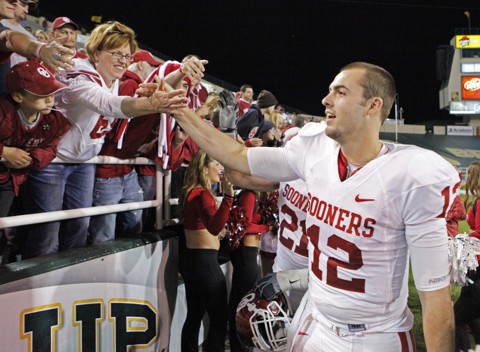 Quarterback Landry Jones greet the fans following the college football game between the University of Oklahoma Sooners (OU) and the Baylor Bears (BU) at Floyd Casey Stadium on Saturday, November 20, 2010, in Waco, Texas. Photo by Steve Sisney, The Oklahoman