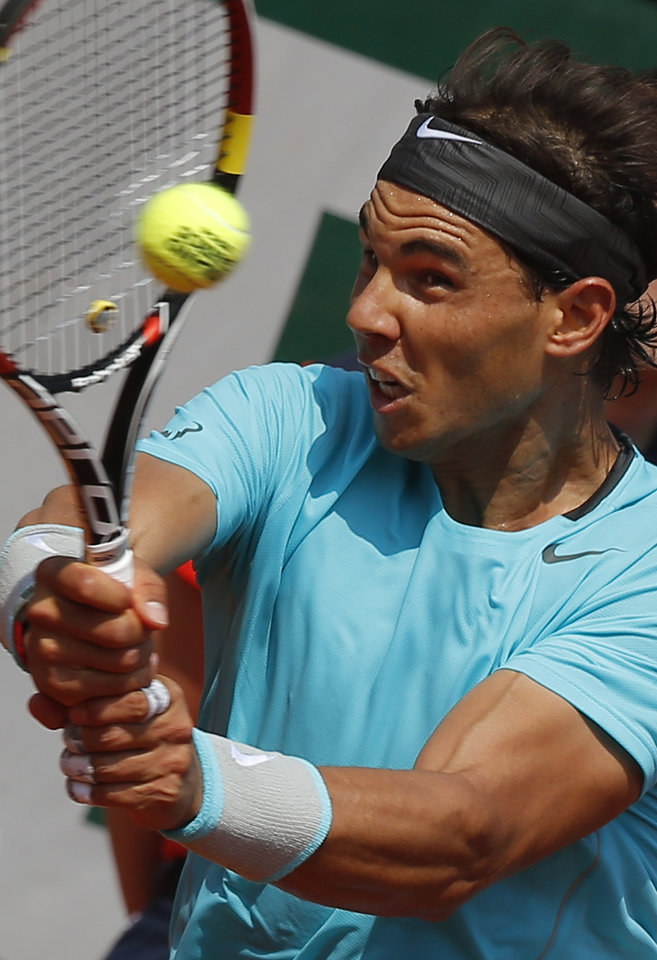 Photo - Spain's Rafael Nadal returns during the third round match of the French Open tennis tournament against Argentina's Leonardo Mayer at the Roland Garros stadium, in Paris, France, Saturday, May 31, 2014. (AP Photo/Michel Euler)