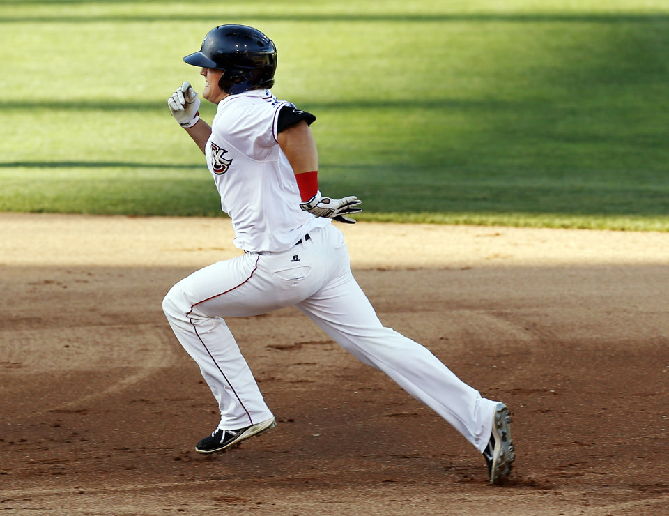 Oklahoma City's Kike Hernandez (6) runs to third base on a triple in the first inning during a minor league baseball game between the Oklahoma City RedHawks and the Las Vegas 51s at the Chickasaw Bricktown Ballpark in Oklahoma City, Friday, June 13, 2014. Photo by Nate Billings, The Oklahoman