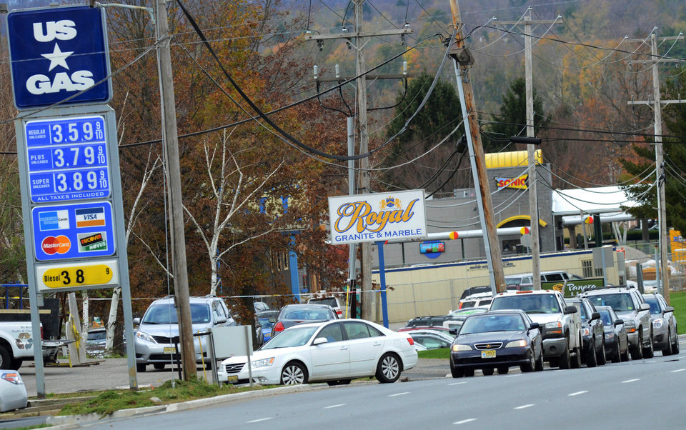 Photo -   Customers line up along Route 22 East at the US Gas, Saturday, Nov. 3, 2012, in Pohatcong Township, N.J., as the gas rationing ordinance goes into effect. Weary of cleaning up from the superstorm that battered the state and with more than 1 million of them still without power, New Jerseyans were handed a new challenge Saturday: rationed gas in the northern half of the state, a system that caused confusion, frustration and desperation. Gov. Chris Christie ordered the rationing system for 12 counties, saying it would help ease fuel shortages and the long lines at gas stations and remain in place as long as Christie deemed a need for it. (AP Photo/The Express-Times, Stephen Flood)