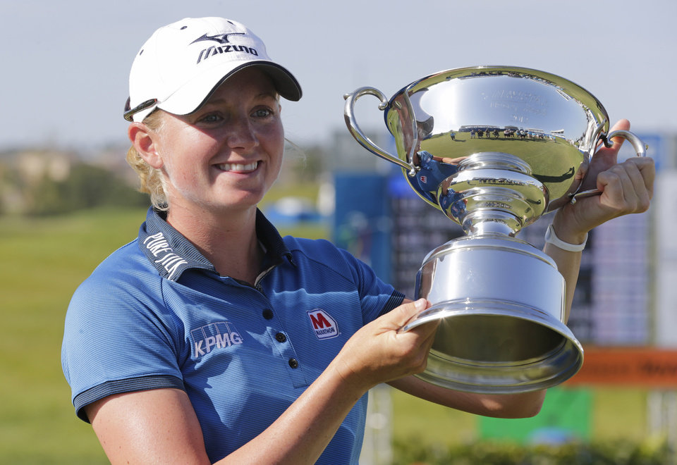 Photo -   Stacy Lewis displays the trophy after winning the Navistar LPGA Classic golf tournament on Sunday, Sept. 23, 2012, at the Robert Trent Jones Golf Trail in Prattville, Ala. (AP Photo/Dave Martin)