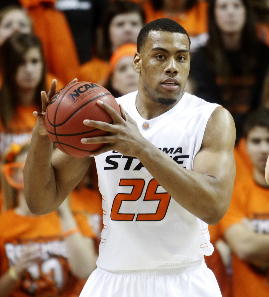 In this photo taken Jan. 26, 2011, Oklahoma State forward Darrell Williams is pictured during an NCAA college basketball game against Texas in Stillwater, Okla. Williams has been charged with a felony count of sexual battery and three felony counts of rape by instrumentation. The Payne County District Attorney's office filed the charges Monday, Feb. 7, 2011, against Williams. (AP Photo/Sue Ogrocki)