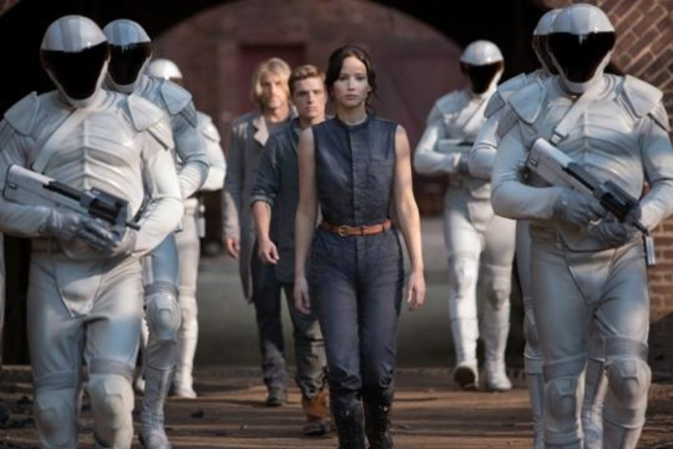 """Photo -  Jennifer Lawrence stars as Katniss Everdeen, from foreground to background, Josh Hutcherson as Peeta Mellark and Woody Harrelson as Haymitch Abernathy in a scene from """"The Hunger Games: Catching Fire."""""""