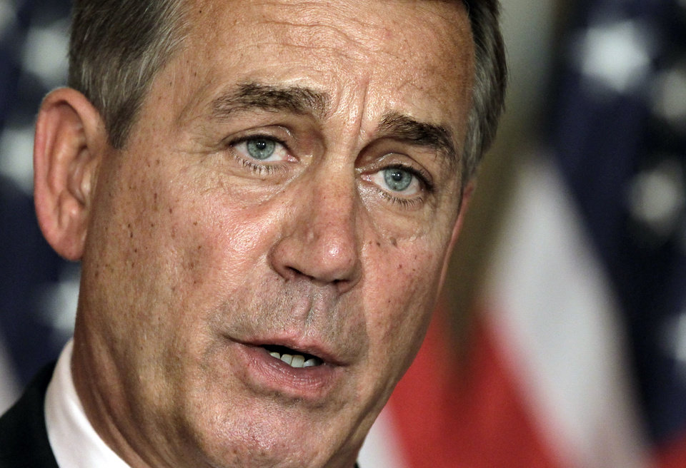 "FILE - In this July 30, 2011, file photo, House Speaker John Boehner, R-Ohio, speaks at a news conference as the debt crisis goes unresolved on Capitol Hill in Washington. Boehner has been caught up in a monumental struggle over taxes and spending aimed at keeping the country from taking a yearend dive over the ""fiscal cliff."" President Barack Obama is tugging Boehner one way in pursuit of a budget deal, while conservatives yank the other way, some howling that the speaker already is going wobbly on them and turning vindictive against those in his party who dare disagree. (AP Photo/J. Scott Applewhite, File)"