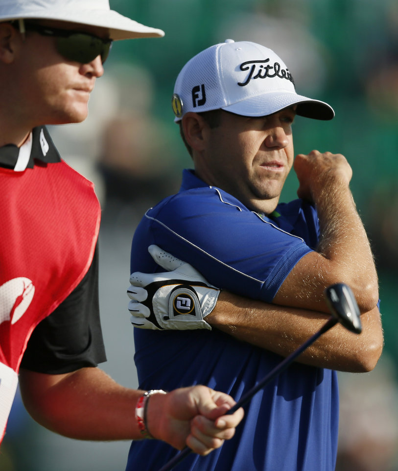 Photo - Erik Compton of the US prepares to play off the 4th tee during the first day of the British Open Golf championship at the Royal Liverpool golf club, Hoylake, England, Thursday July 17, 2014. (AP Photo/Alastair Grant)