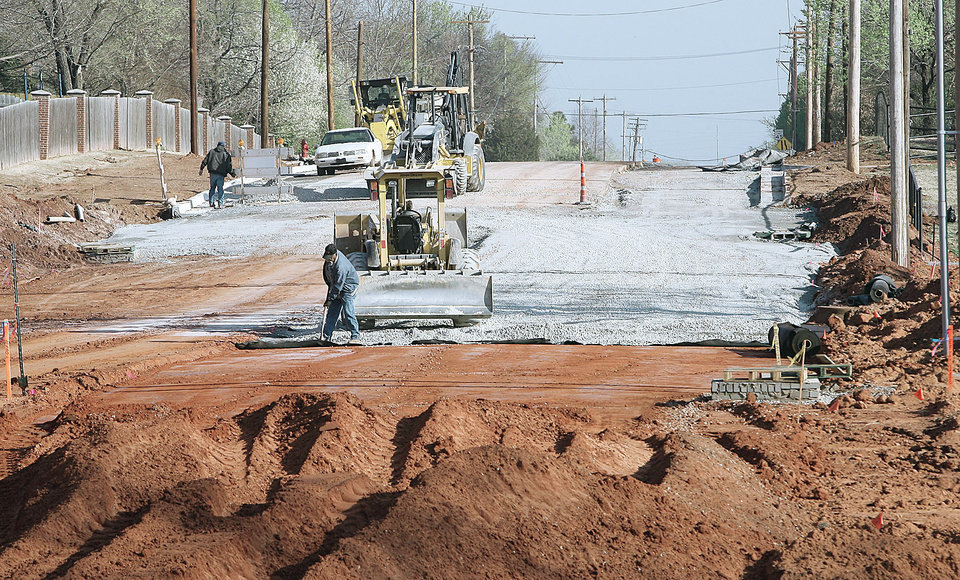 Photo - Looking north on Coltrane Road, construction work is continuing as crews build a new bridge north of SE 15th. PHOTOS BY PAUL B. SOUTHERLAND, THE OKLAHOMAN