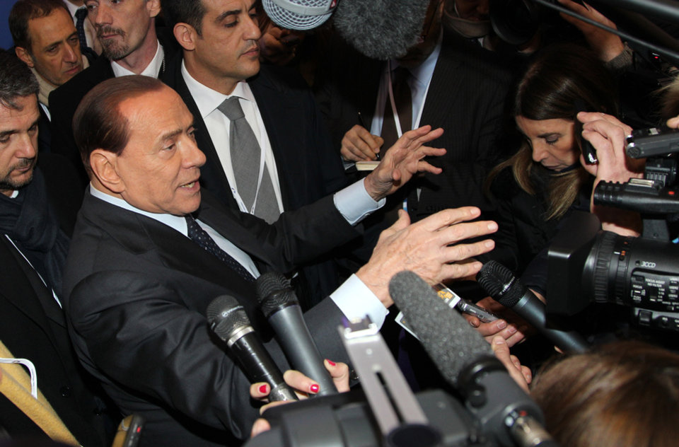 Italy's EPP party member Silvio Berlusconi talks to the media at the end of the European People's Party summit, ahead of the EU summit in Brussels on Thursday, Dec. 13, 2012. In one whirlwind morning, the European Union nations agreed on the foundation of a fully-fledged banking union and Greece's euro partners approved billions of euros in bailout loans that will prevent the nation from going bankrupt. (AP Photo/Yves Logghe)