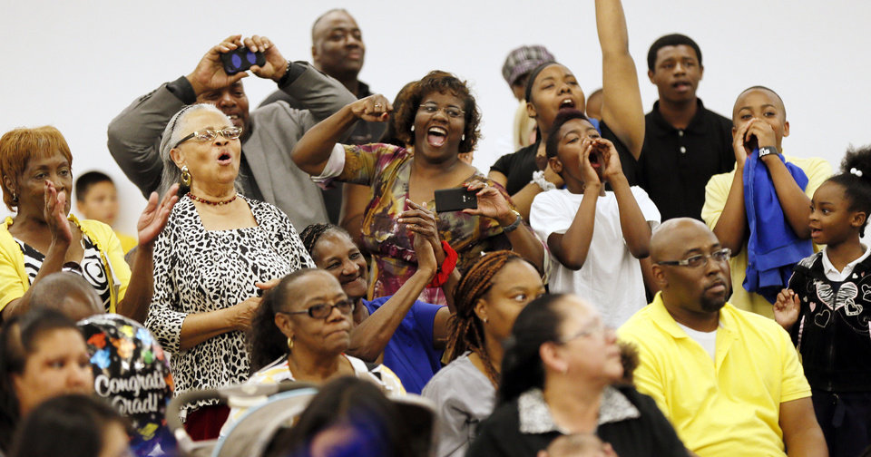 Photo - Family and friends cheer for a graduate during the graduation ceremony for Emerson High School at the Oklahoma City campus of Langston University, Thursday, May 16, 2013. Emerson is an alternative education high school for students who need non-traditional learning because of a variety of reasons including teen pregnancy, homelessness and a need to work to support family.  Photo by Nate Billings, The Oklahoman