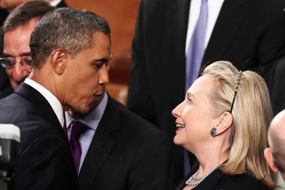 "WASHINGTON, DC - JANUARY 24: U.S. President Barack Obama greets Secretary of State Hillary Rodham Clinton at his State of the Union address on January 24, 2012 in Washington, DC. Obama said the focal point his speech is the central mission of our country, and his central focus as president, including ""rebuilding an economy where hard work pays off and responsibility is rewarded."" (Photo by Win McNamee/Getty Images)"