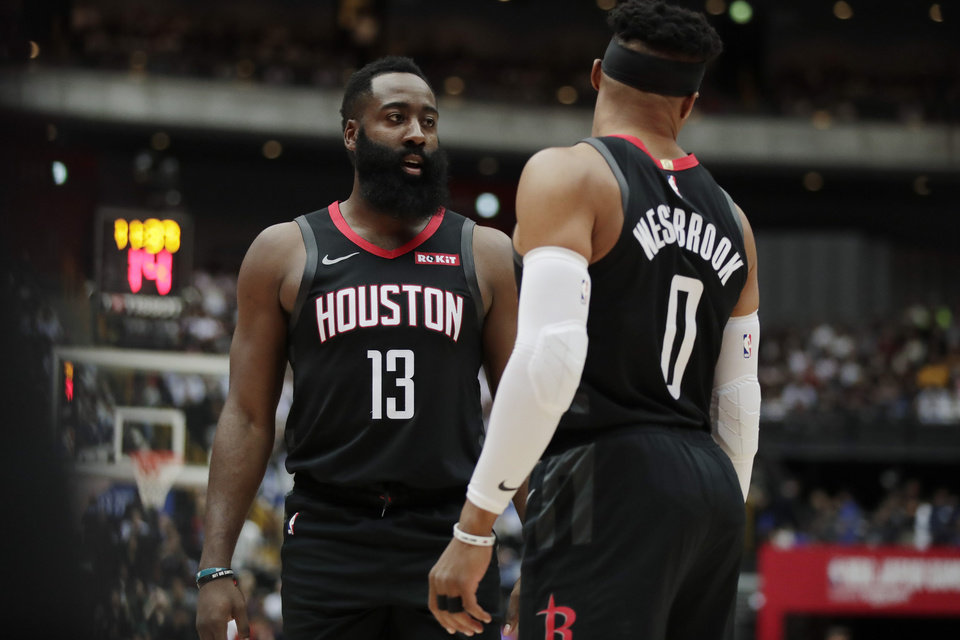 Photo - Houston Rockets' James Harden, left, talks to Russell Westbrook during the first half of an NBA preseason basketball game against the Toronto Raptors Tuesday, Oct. 8, 2019, in Saitama, near Tokyo. (AP Photo/Jae C. Hong)