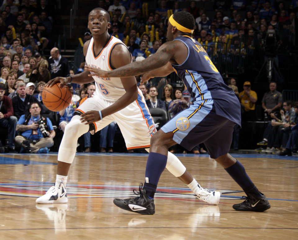 Oklahoma City's Reggie Jackson (15) looks to pass the ball as Denver's Ty Lawson (3) defends during the NBA basketball game between the Oklahoma City Thunder and the Denver Nuggets at the Chesapeake Energy Arena, Sunday, Feb. 19, 2012. Photo by Sarah Phipps, The Oklahoman