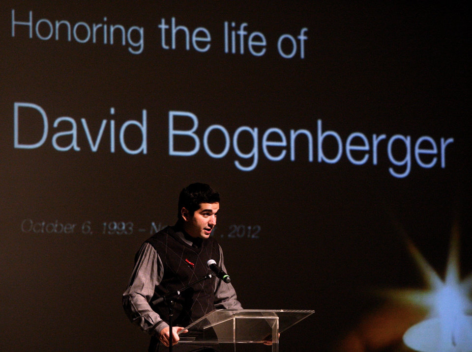 In this Nov. 7, 2012 photo, Anthony Buda, president of Northern Illinois University's Interfraternity Council, speaks at a memorial gathering for student and Pi Kappa Alpha pledge David Bogenberger in the Carl Sandburg Auditorium in the Holmes Student Center in DeKalb, Ill. Nearly two dozen Pi Kappa Alpha members at Northern Illinois University have been charged with hazing-related counts after Bogenberger was found dead at their fraternity house following a night of drinking. (AP Photo/Daily Chronicle, Kyle Bursaw) CHICAGO LOCALS OUT; ROCKFORD REGISTER STAR OUT; MANDATORY CREDIT