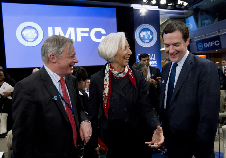 Photo - International Monetary Fund (IMF) Managing Director Christine Lagarde, center, speaks with Britain's Chancellor of the Exchequer George Osborne, right, and Governor of the Banque de France Christian Noyer, left, during the International Monetary and Financial Committee (IMFC) at World Bank Group-International Monetary Fund Spring Meetings in Washington, Saturday, April 12, 2014. ( AP Photo/Jose Luis Magana)