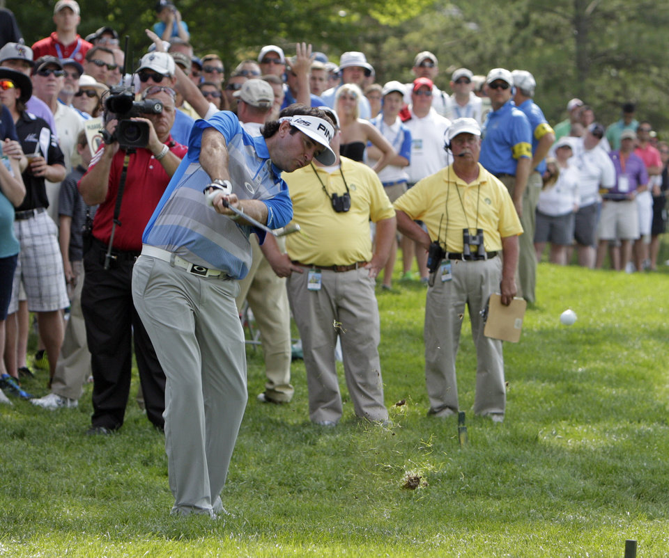 Photo - Bubba Watson hits to the 13th green during the final round of the Memorial golf tournament Sunday, June 1, 2014, in Dublin, Ohio. (AP Photo/Jay LaPrete)