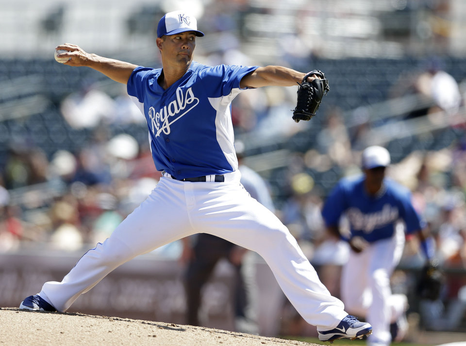 Kansas City Royals starting pitcher Jeremy Guthrie throws against the Cleveland Indians during the third inning in an exhibition spring training baseball game on Friday, March 29, 2013, in Surprise, Ariz. (AP Photo/Gregory Bull)