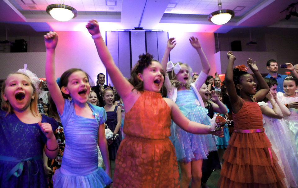 These girls express their delight as a favorite song is played. Midwest City Parks and Recreation Department hosted the city's annual Daddy-Daughter Dance that featured three 90-minute dance sessions at the Reed Center on Saturday, Feb. 16, 2013.    Photo by Jim Beckel, The Oklahoman