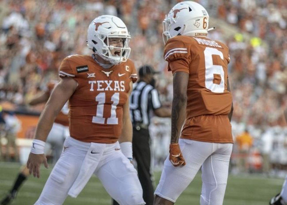 Photo -  Texas quarterback Sam Ehlinger (11) celebrates with Joshua Moore (6) after a touchdown against UTEP on Sept. 12. [Ricardo B. Brazziell/Austin American-Statesman]