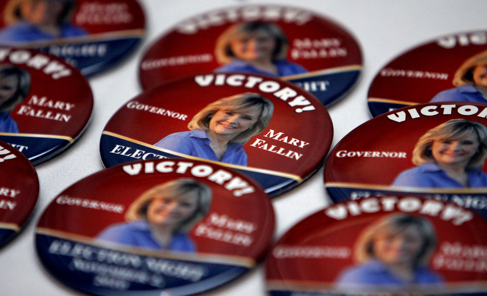 Photo - Mary Fallin pins sit on a table for republican party supporters at the republican Watch Party at the Marriott on Tuesday, Nov. 2, 2010, in Oklahoma City, Okla.   Photo by Chris Landsberger, The Oklahoman