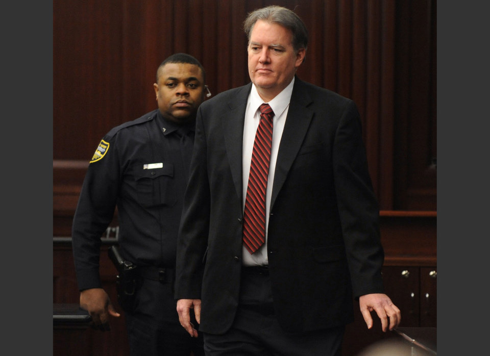 Photo - Defendant Michael Dunn is brought into the courtroom just before 5 p.m., where Judge Russell Healey announced that the jury was deadlocked on charge one and have verdicts on the other four charges as they deliberate in the trial of Dunn, Saturday, Feb. 15, 2014, for the shooting death of Jordan Davis in November 2012. Dunn is charged with fatally shooting 17-year-old Davis after an argument over loud music outside a Jacksonville convenient store. (AP Photo/The Florida Times-Union, Bob Mack, Pool)