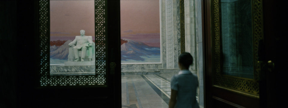 In this Sept. 10, 2012 photo, a woman enters the front doors of the Grand People\'s Study House where a statue of the late leader Kim Il Sung stands in Pyongyang, North Korea. (AP Photo/David Guttenfelder)