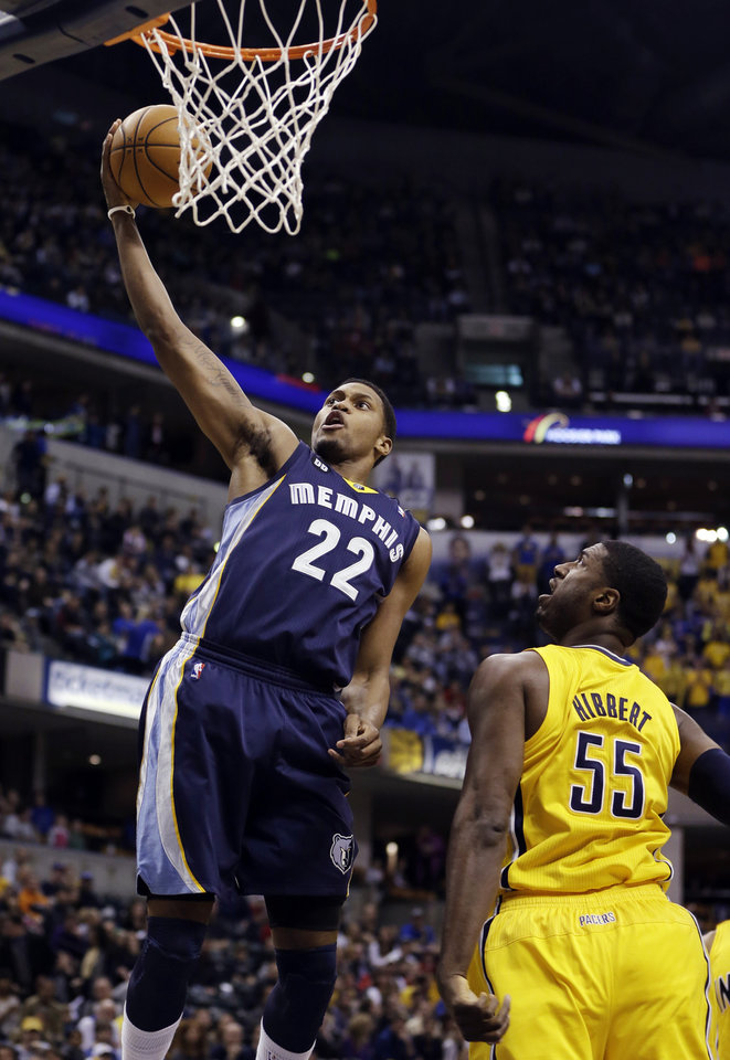 Photo - Memphis Grizzlies' Rudy Gay (22) shoots against Indiana Pacers' Roy Hibbert (55) during the first half of an NBA basketball game, Monday, Dec. 31, 2012, in Indianapolis. (AP Photo/Darron Cummings)