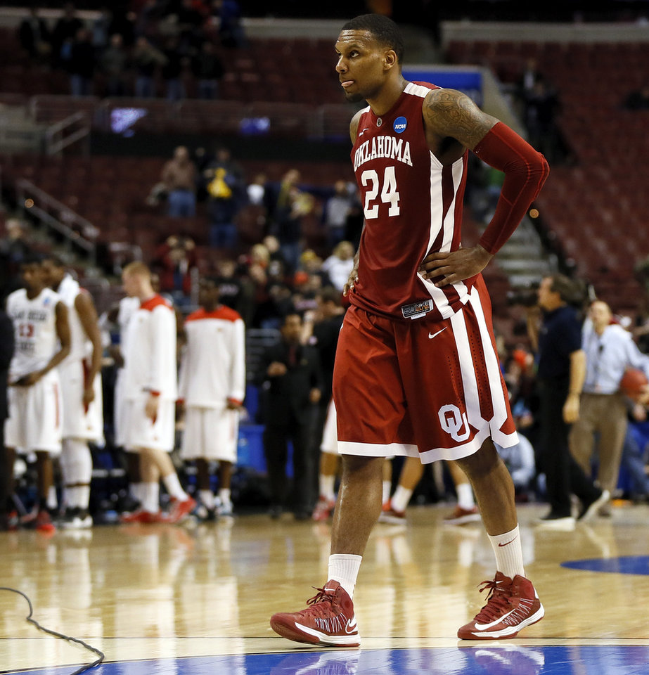 Oklahoma\'s Romero Osby (24) leaves the court after a game between the University of Oklahoma and San Diego State in the second round of the NCAA men\'s college basketball tournament at the Wells Fargo Center in Philadelphia, Friday, March 22, 2013. San Diego State beat OU, 70-55. Photo by Nate Billings, The Oklahoman