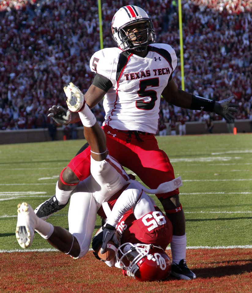 Oklahoma's Ryan Broyles (85) is rolled up under Texas Tech's Tre' Porter (5) on a touchdown reception during the first half of the college football game between the University of Oklahoma Sooners (OU) and the Texas Tech Red Raiders (TTU) at the Gaylord Family Memorial Stadium on Saturday, Nov. 13, 2010, in Norman, Okla.  Photo by Chris Landsberger, The Oklahoman