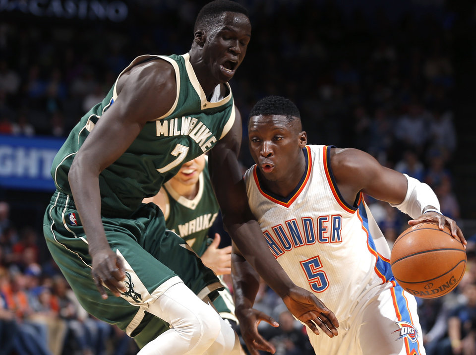 Photo - Oklahoma City's Victor Oladipo (5) goes past Milwaukee's Thon Maker (7) during an NBA basketball game between the Oklahoma City Thunder and the Milwaukee Bucks at Chesapeake Energy Arena in Oklahoma City, Tuesday, April 4, 2017. Photo by Bryan Terry, The Oklahoman
