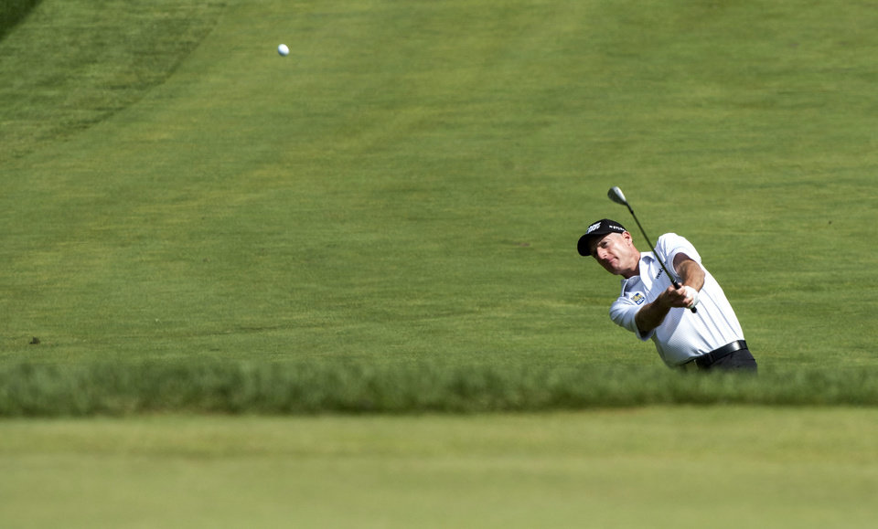 Photo - Jim Furyk chips on to the sixth green during the third round of the Canadian Open golf championship at the Royal Montreal Golf Club in Montreal, Saturday, July 26, 2014. (AP Photo/The Canadian Press, Paul Chiasson)
