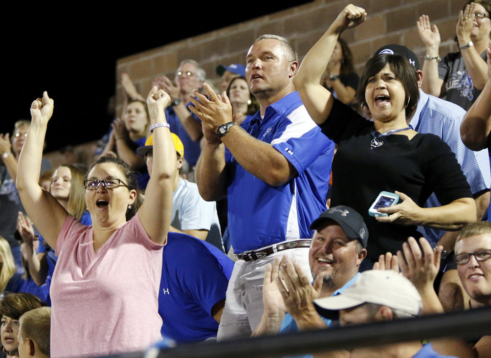 Guthrie head coach Rafe Watkins, middle, reacts along with his wife, Kren Watkins, right, and other fans during a high school football game between Guthrie and Guymon at Jelsma Stadium in Guthrie, Okla., Friday, Sept. 21, 2012. Watkins has watched the last 8 games from the stands as he served a suspension dating back to last year. Photo by Nate Billings, The Oklahoman