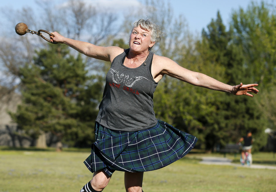 Photo -  Terri Ventress practices throwing weight for distance, a Highland Games event, at Siler Park on Monday. [Photo by Nate Billings, The Oklahoman]