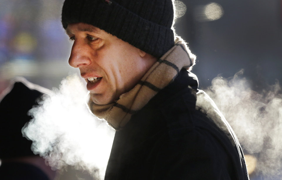 Photo - A man is bundled up against the cold on New York's 34th Street in Midtown Manhattan Wednesday, Jan. 23, 2013. The temperature was around 12 degrees, but with wind gusts of 15-20 mph, it felt more like five below as people started their day in New York City. (AP Photo/Mark Lennihan)
