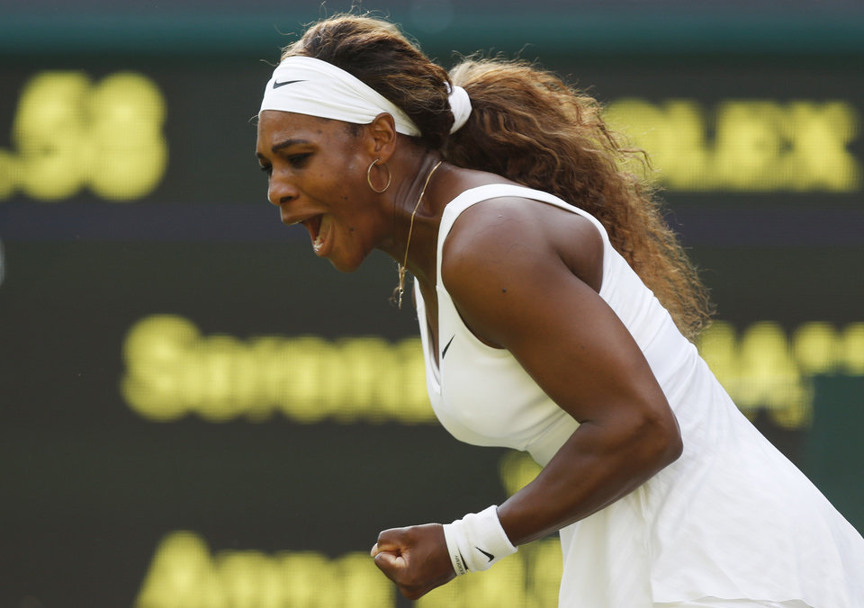 Photo - Serena Williams of U.S.  celebrates after winning a point against Anna Tatishvili of U.S. in their match at the All England Lawn Tennis Championships in Wimbledon, London, Tuesday, June 24, 2014. (AP Photo/Sang Tan)