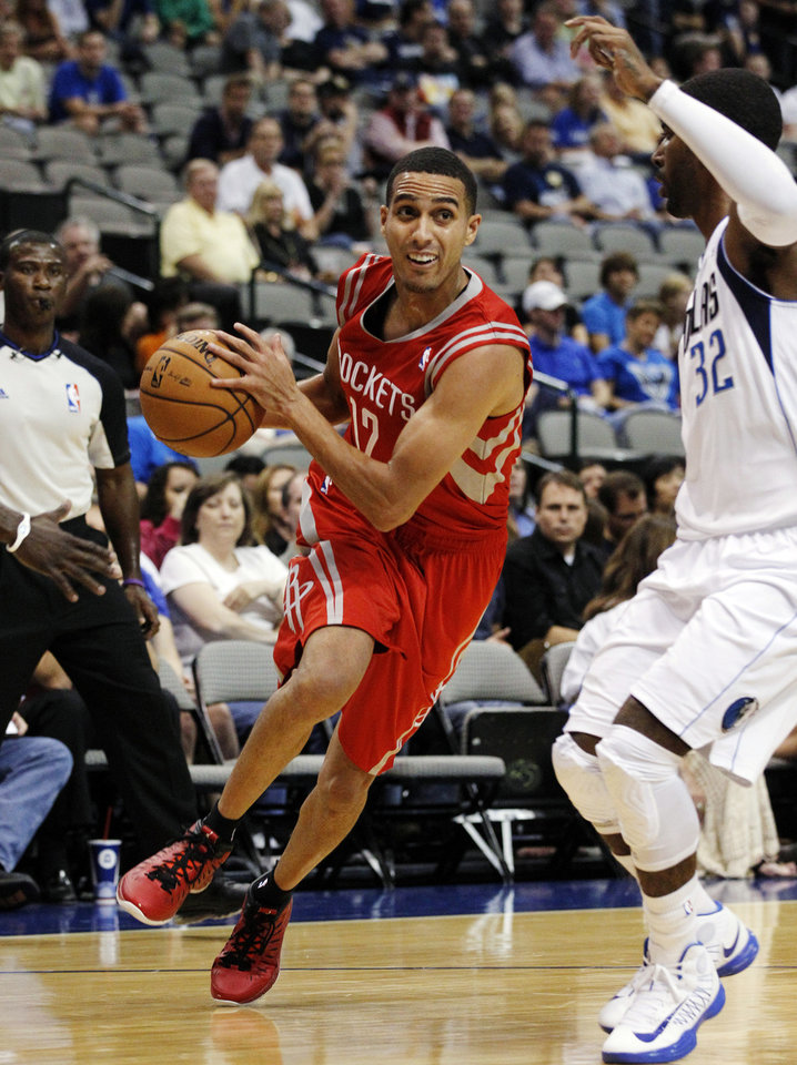 Houston Rockets guard Kevin Martin (12) drives against Dallas Mavericks' O.J. Mayo (32) in the first half of a preseason NBA basketball game, Monday, Oct. 15, 2012, in Dallas. Martin scored 23 points in their 123-104 loss to the Mavericks. (AP Photo/Tony Gutierrez) ORG XMIT: DNA112