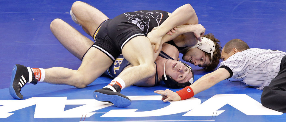 Photo - Oklahoma State's Alex Dieringer, back, takes on Drexel's Austin Sommer in the 157 pound match during the 2014 NCAA Div. 1 Wrestling Championships at Chesapeake Energy Arena in Oklahoma City, Okla. on Thursday, March 20, 2014. Photo by Chris Landsberger, The Oklahoman