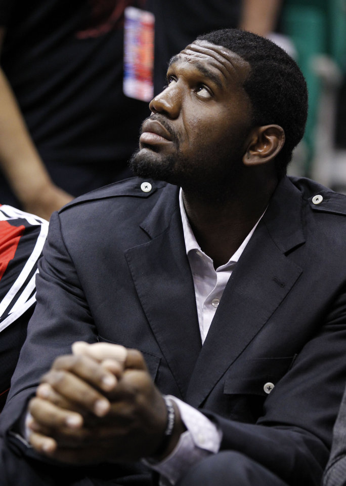 "FILE - In this Oct. 7, 2010, file photo, Portland Trail Blazers Greg Oden sits on the bench during the first half of their NBA preseason basketball game against the Utah Jazz in Salt Lake City. With Oden neeeding another knee operation and missing another season, Portland coach Nate McMillan confronts the ""Curse of the Trail Blazers' Big Men."" (AP Photo/Colin E Braley, File) ORG XMIT: NY177"