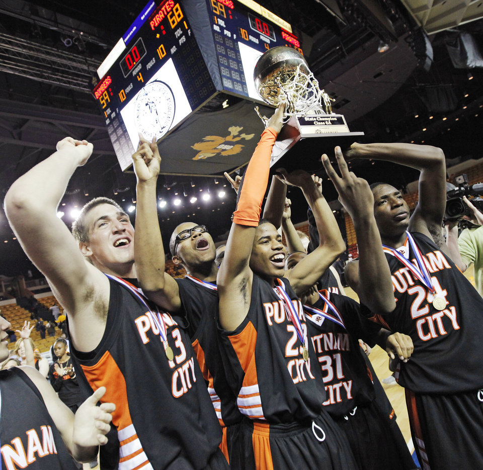 The Putnam City Pirates raise the gold ball championship trophy after the Class 6A high school basketball state tournament final between Putnam City and Midwest City at the ORU Mabee Center in Tulsa, Okla., Saturday, March 13, 2010. Putnam City won, 68-59. Photo by Nate Billings, The Oklahoman