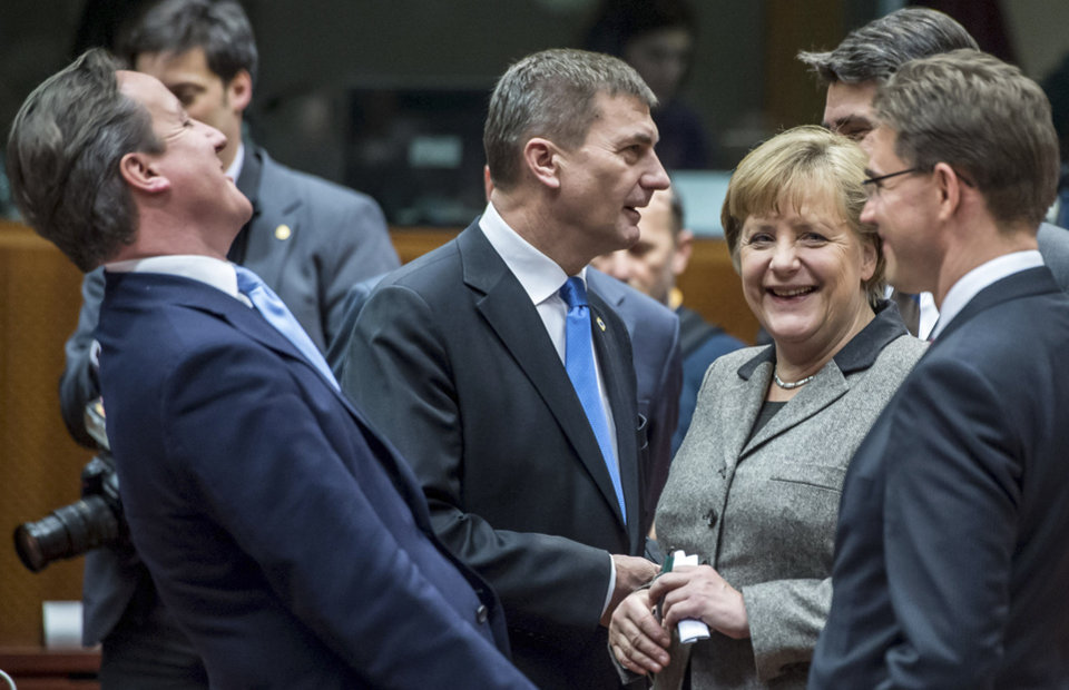 British Prime Minister David Cameron, left, laughs as he speaks with from right, Finland\'s Prime Minister Jyrki Tapani Katainen, Croatian Prime Minister Zoran Milanovic, German Chancellor Angela Merkel and Estonia\'s Prime Minister Andrus Ansip during a round table meeting at an EU summit in Brussels on Thursday, Dec. 13, 2012. In one whirlwind morning, the European Union nations agreed on the foundation of a fully-fledged banking union and Greece's euro partners approved billions of euros in bailout loans that will prevent the nation from going bankrupt. (AP Photo/Geert Vanden Wijngaert)