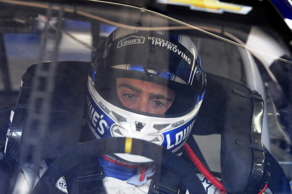 Photo - Driver Jimmie Johnson waits in his car before practice for Saturday's NASCAR Sprint Cup series auto race at Charlotte Motor Speedway in Concord, N.C., Friday, May 16, 2014. (AP Photo/Mike McCarn)