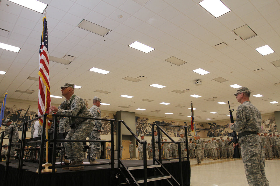 Photo - The presentation of colors during a the 45 Infantry Combat Team Change of Command Ceremony at the Norman Armed Forces Reserve Center, Sunday, June 3, 2012.  Photo by Garett Fisbeck, The Oklahoman