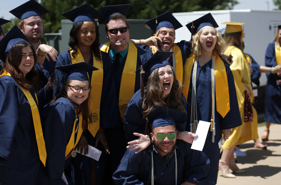 Photo -  Graduates pose for a picture before their commencement ceremony at the University of Central Oklahoma in Edmond. [STAFF PHOTO BY SARAH PHIPPS, THE OKLAHOMAN]