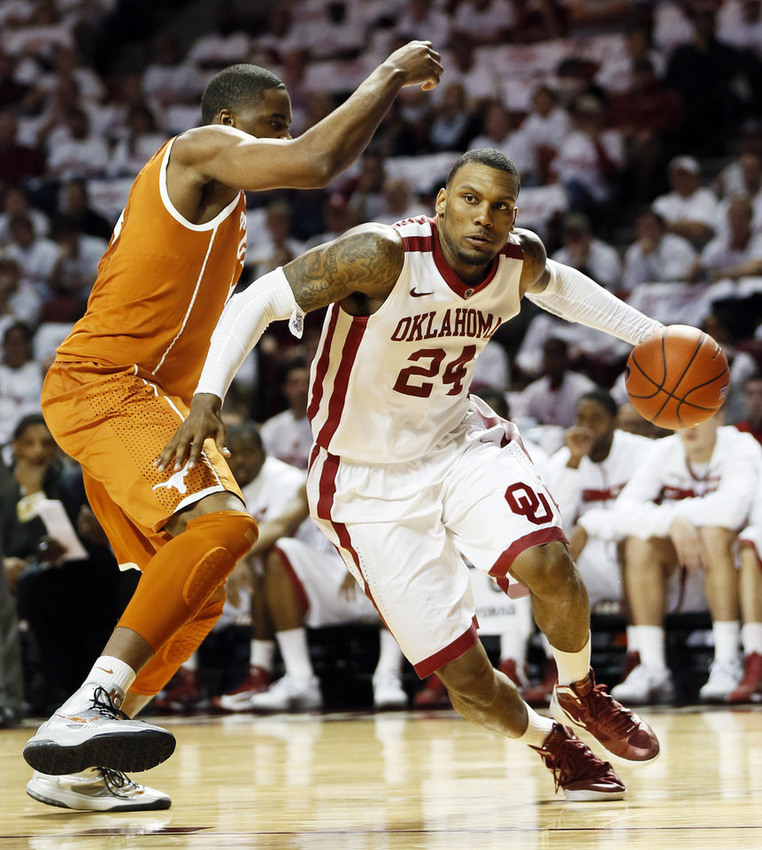 Photo - Oklahoma's Romero Osby (24) drives the ball against Texas' Prince Ibeh (44) during a men's college basketball game between the University of Oklahoma and the University of Texas at the Lloyd Noble Center in Norman, Okla., Monday, Jan. 21, 2013. OU won, 73-67. Photo by Nate Billings, The Oklahoman