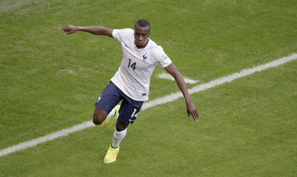 Photo - France's Blaise Matuidi celebrates scoring his side's second goal during the group E World Cup soccer match between Switzerland and France at the Arena Fonte Nova in Salvador, Brazil, Friday, June 20, 2014. (AP Photo/Sergei Grits)