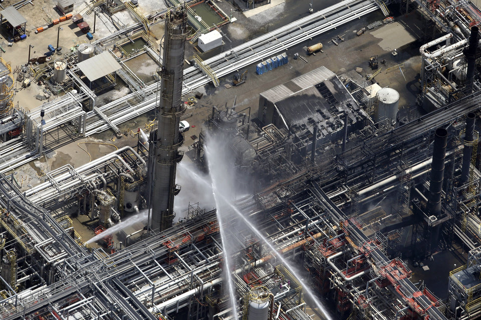 Photo - A chemical plant fire is seen in an aerial photo about twenty miles southeast of Baton Rouge, in Geismer, La., Thursday, June 13, 2013. The plant makes highly flammable gases that are basic building blocks in the petrochemical industry. (AP Photo/Gerald Herbert)